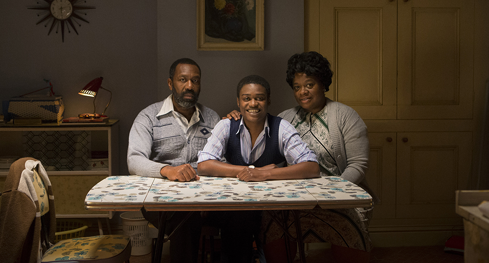 Danny (Kascion Franklin), Samson (Lenny Henry), Myrtle (Cecilia Noble) sit at kitchen table