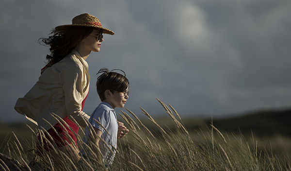 Vera (Mave Dermody) and Cyril Claythorne (Charlie Gallacher) walking in long grass