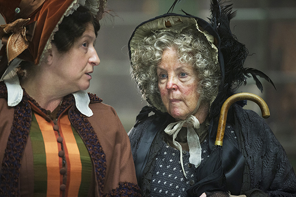 Mrs Gamp (Pauline Collins) gossips with Mrs. Bumble (Caroline Quentin)