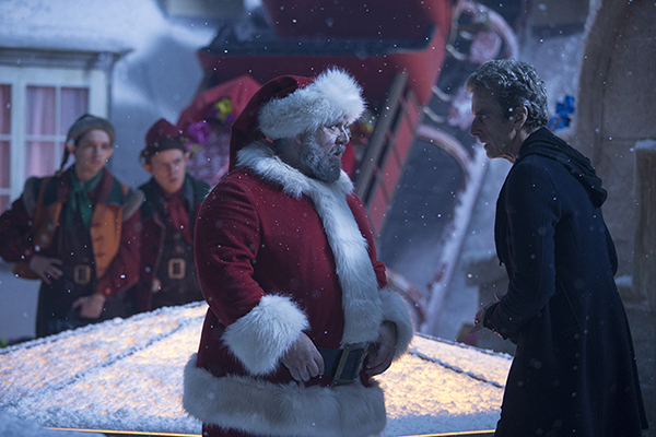 Santa (Nick Frost) with The Doctor (Peter Capaldi) on a snowy rooftop
