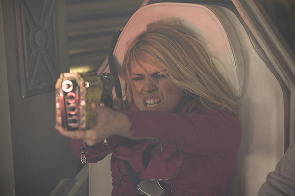 Rose (Billie Piper) raises weapon, hair blowing, sat in seat
