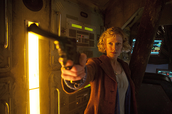 Madge Arwell (Claire Skinner) branishes a pistol from Doctor Who episode The Doctor The Widow And The Wardrobe