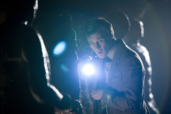 The Doctor (Matt Smith) looking at camera with torch