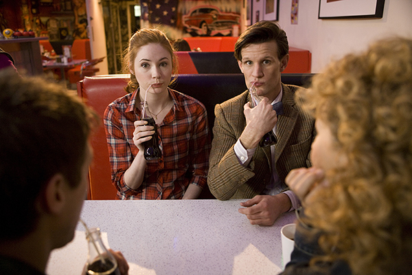 unit still photo of Amy and The Doctor drinking through strawers
