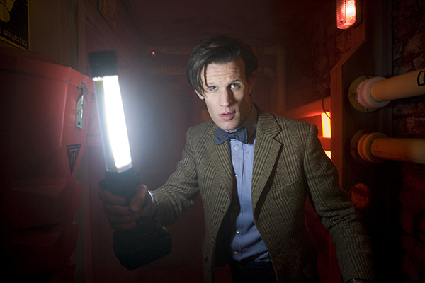 film still photo of The Doctor in a corridor with a lamp