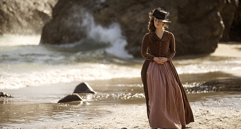 Elizabeth (Heida Reed) walking on beach alone