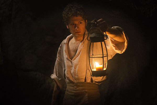 Francis (Kyle Soller) holding lamp in mine