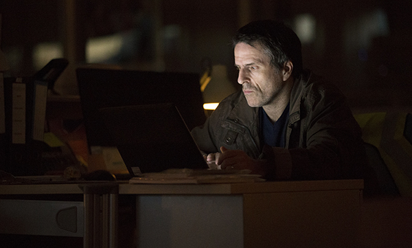 TV series Oridinary Lies - Joe (Con O'Neill) sitting in the dark looking at laptop